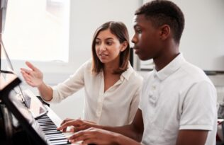piano student with teacher