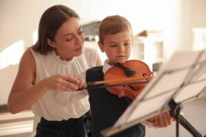 Violin student and teacher