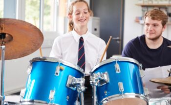 girl taking drum lessons